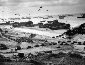 Landing ships, including Dad's, USS 533 at far right, delivering cargo to Omaha Beach, mid-June, 1944. [Wikimedia Commons]